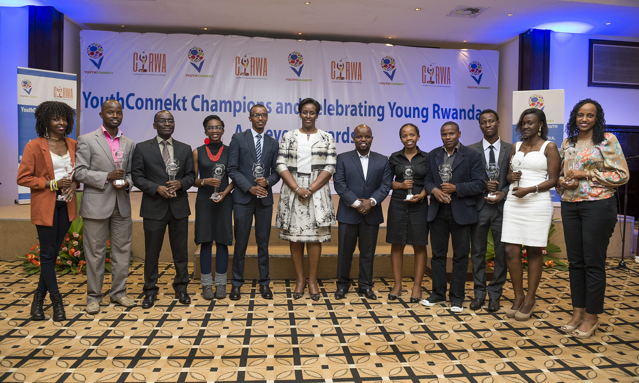 Lady Jeannette Kagame (C), on her right is MYICT Minister Philbert Nsengimana, and the awardees